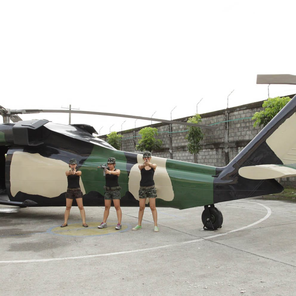 Blackhawk helicopter with girls and guns Rear angle view