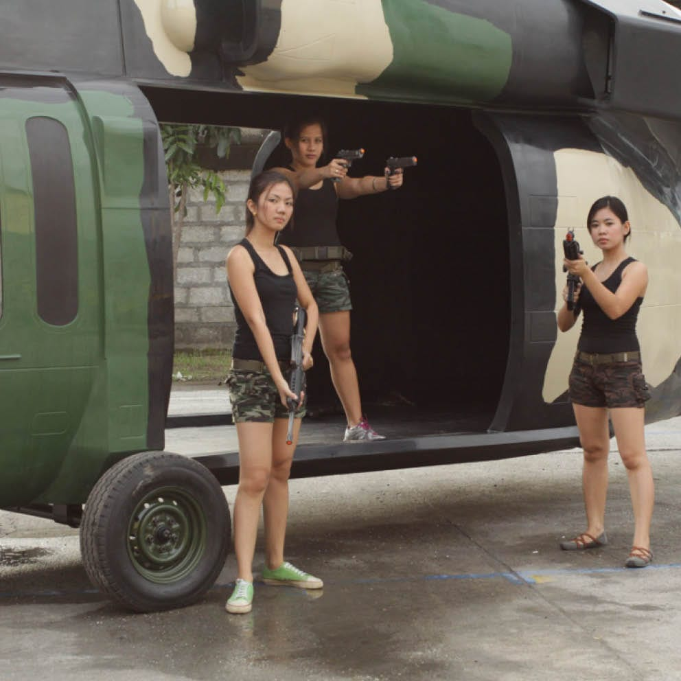 Blackhawk helicopter with girls and guns situ