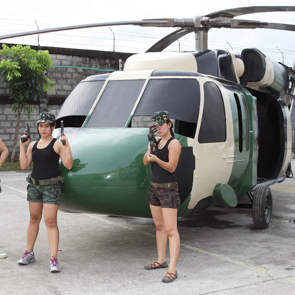 Blackhawk helicopter with girls and guns situ front view