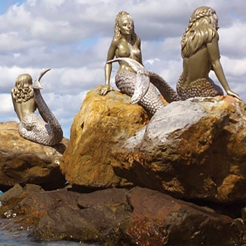Daydream Island Mermaids on rock