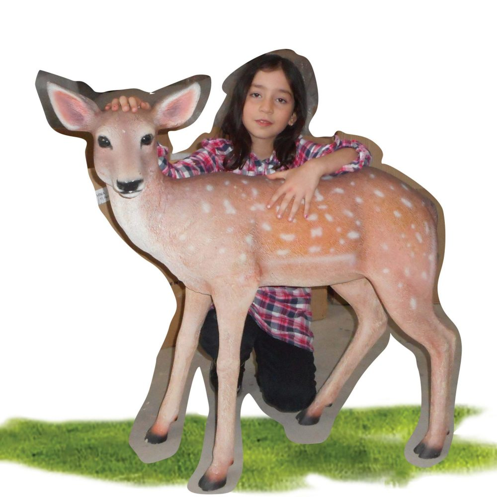 Cute deer fawn - statue in standing pose - with girl