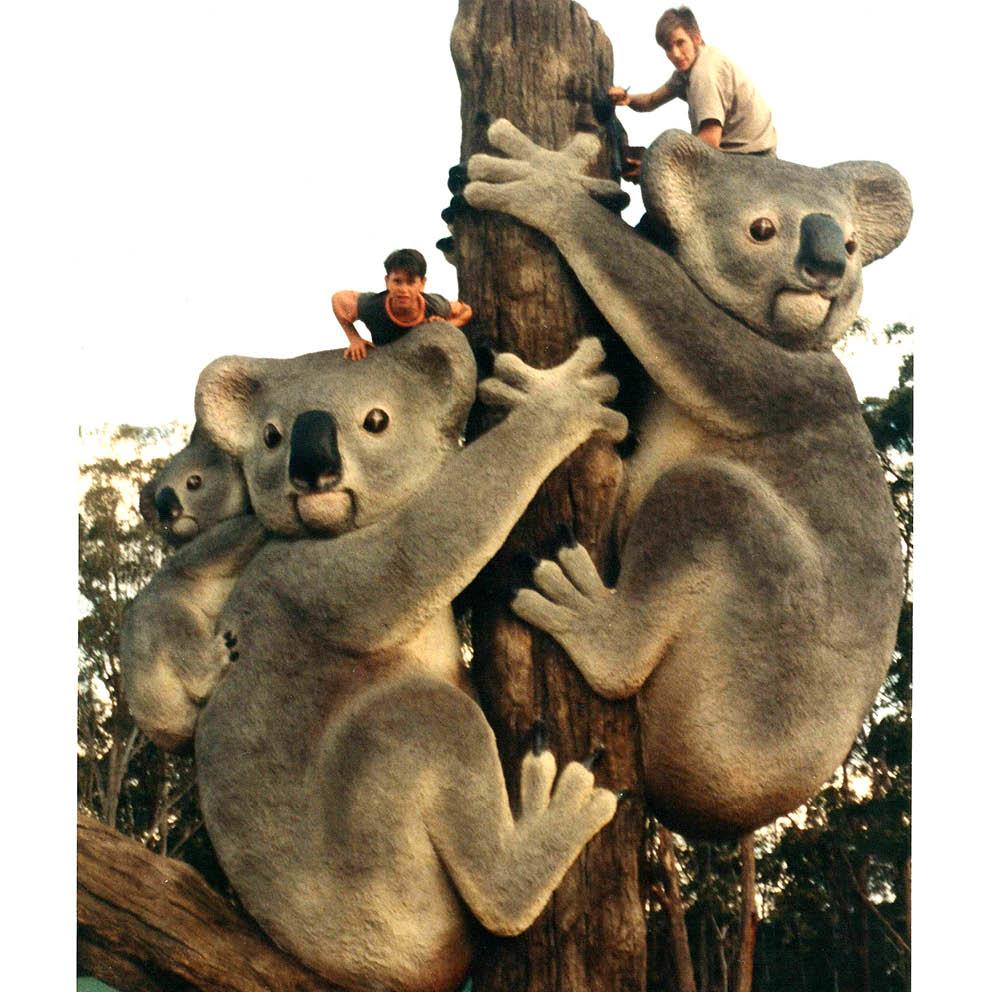 Giant Koalas on Tree Stump with  boys