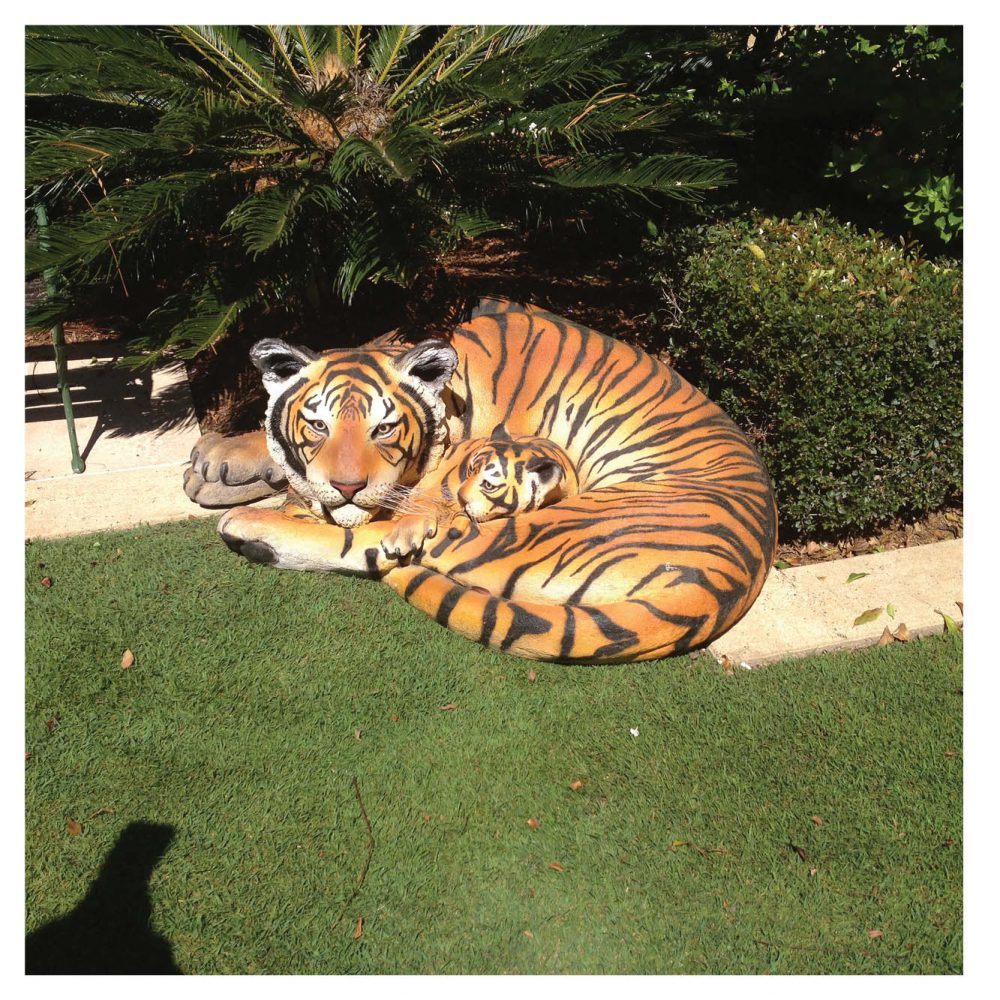 Bengal Tigress Resting With Cub. Tiger Statue - outside in garden