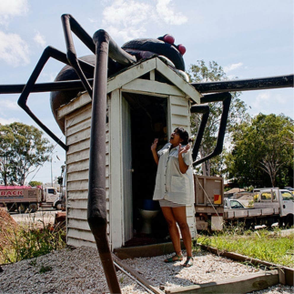 Redback Spider Giant with scared lady