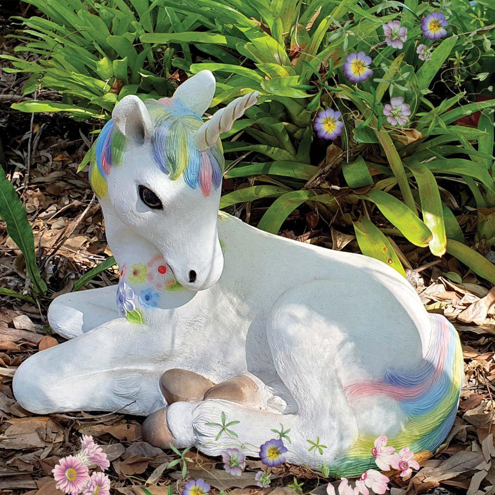 Unicorn foal resting - statue - rainbow colour -outside view