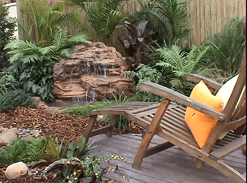 rocks in yard with chair