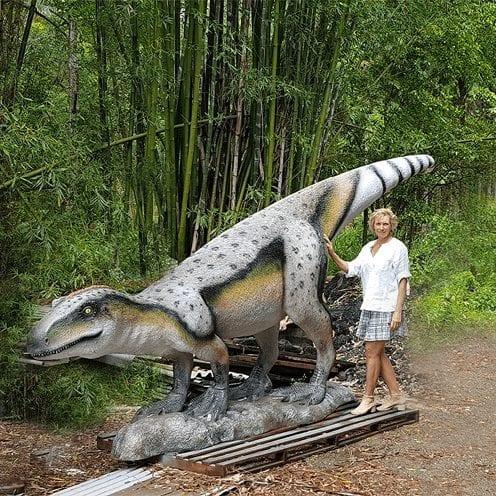 Rosewood Raptor Dinosaur Standing outside